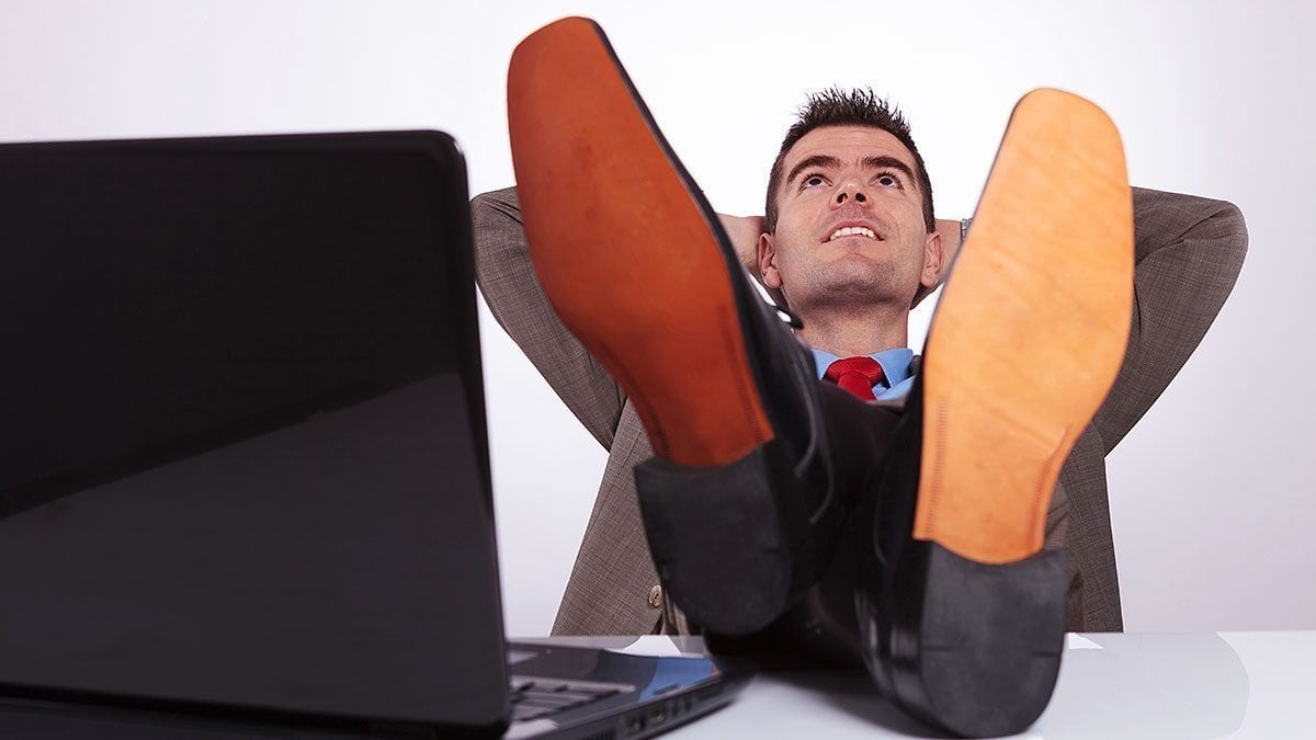 business student reclines in a popular—and presidential—power pose.