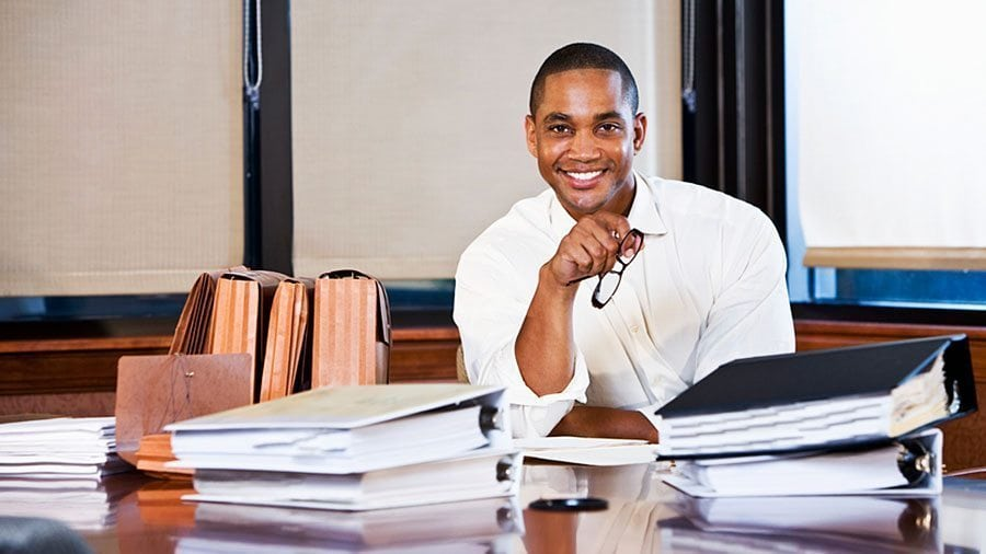 A graduate of accounting training manages the ledgers and accounts of his clients