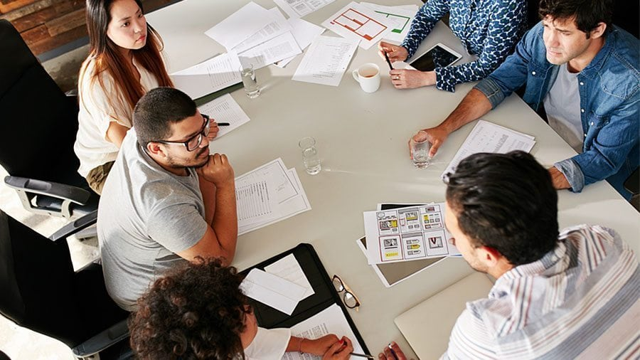 Business and marketing professionals work together to develop key client personas